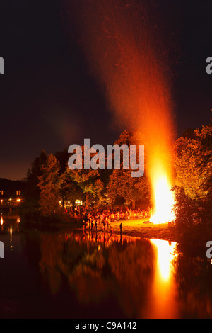 Germany, Bavaria, Upper Bavaria, Wolfratshausen, People celebrating midsummer festival - Stock Photo