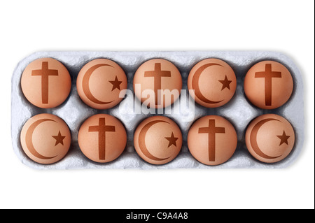 Box of eggs with Christian and Islamic symbols of religious doctrines printed on each one.  White background, Cutout - Stock Photo