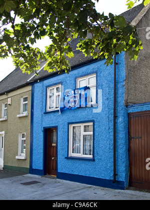 A small house decorated in the colours of the Dublin Gaelic football team with it's flag- Skerries, county Dublin, - Stock Photo