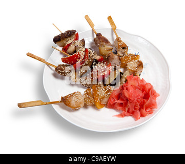 Meat skewers on a plate isolated on white background - Stock Photo