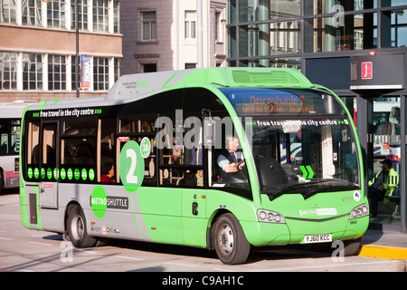 A hybrid diesel electric shuttle bus that is a free bus service around Manchester city centre, UK. - Stock Photo