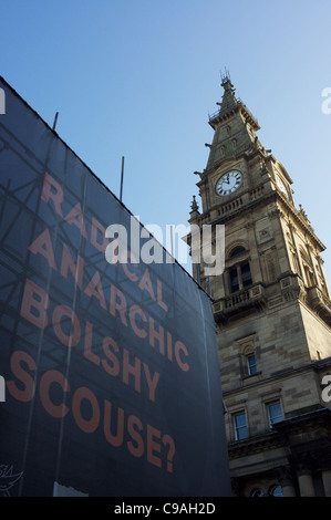 Liverpool Municipal Building's Clock Tower and Scouse Sign Advertising the 'City of Radicals 2011' Arts Festival - Stock Photo