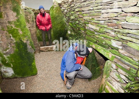 Unstan Chambered Cairn is a stone age burial mound near Stenness on Orkney's Mainland. - Stock Photo
