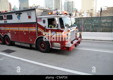 New York Fire Department Rescue Squad 1 rushes to an emergency call - Stock Photo