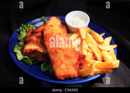 Beer battered fish and chips, shot with a shallow depth of field - Stock Photo