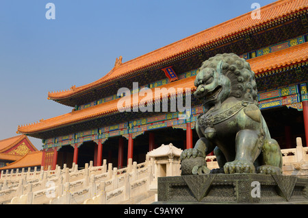 Powerful bronze male lion at the Gate of Supreme Harmony in the Forbidden City Beijing Peoples Republic of China - Stock Photo