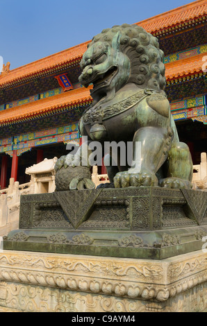 Bronze male lion symbol of power at the Gate of Supreme Harmony in the Forbidden City Beijing Peoples Republic of - Stock Photo