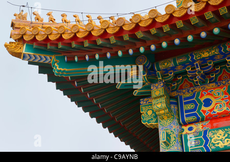 Detail of painted building and roof in the Hall of Supreme Harmony Square in Forbidden City Beijing Peoples Republic - Stock Photo