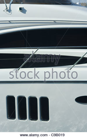 Windows on a large expensive private luxury motor cruiser yacht yachts millionaire wealthy wealth rich success - Stock Photo