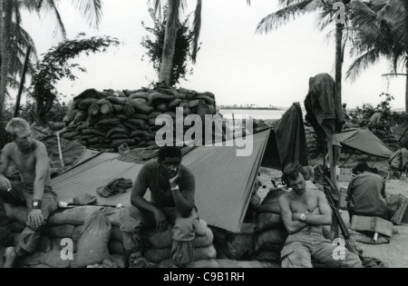 soldiers resting next to sandbags bunkers. 101st ABN in the Ashau Valley during the Vietnam War. - Stock Photo