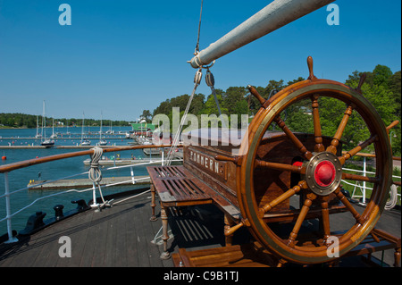Traditional wooden ship steering wheel. The musuem ship Pommern. Mariehamn. Aland. Finland - Stock Photo