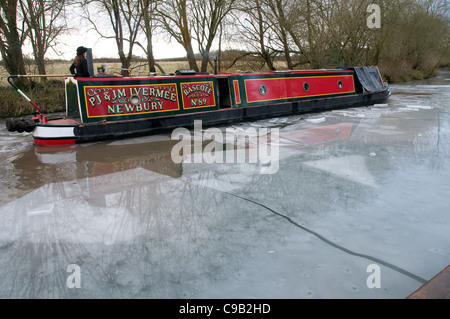 A Narrowboat breaking ice on the Kennet & Avon Canal - Stock Photo
