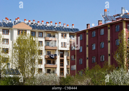 Apartment buildings with solar panels and water tanks on roof, Van, Eastern Anatolia, Turkey - Stock Photo