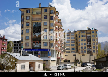 Apartment building with solar panels and water tanks on roof, Van, Eastern Anatolia, Turkey - Stock Photo