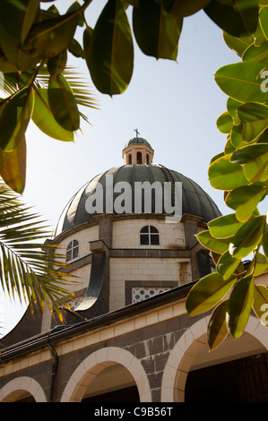 The dome of the Church of the Beatitudes rises above the Mount of the Beatitudes near the Sea of Galilee in northern - Stock Photo