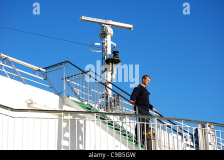 captain on deck in cruise ship - Stock Photo