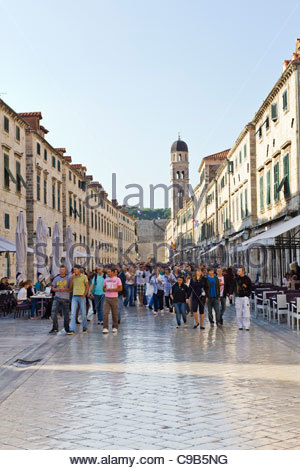 Tourists visiting the old walled town in Dubrovnik, Croatia - Stock Photo