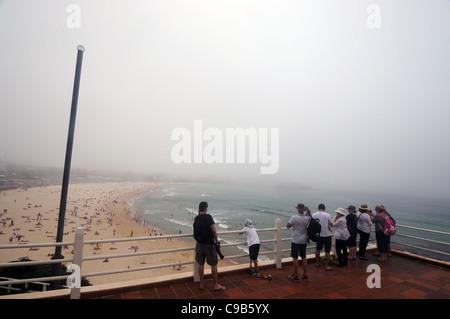 View over crowded Bondi Beach as an unusual sea fog rolls in, Sydney, Australia. 20 Nov 2011. No MR or PR - Stock Photo