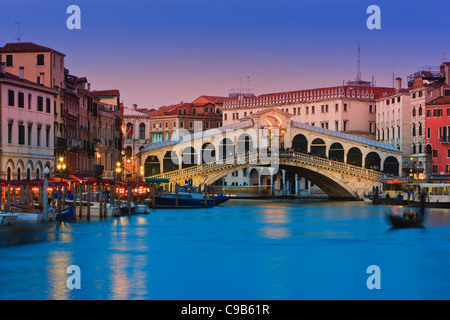 Sunset in Venice with the view to the Rialto Bridge over the Grand Canal - Stock Photo