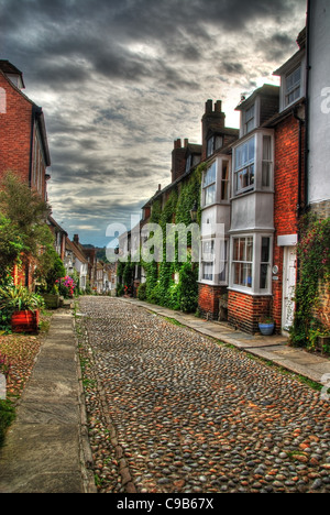 HDR image of a famous cobbled Mermaid Street in a small town Rye, East Sussex - Great Britain - Stock Photo