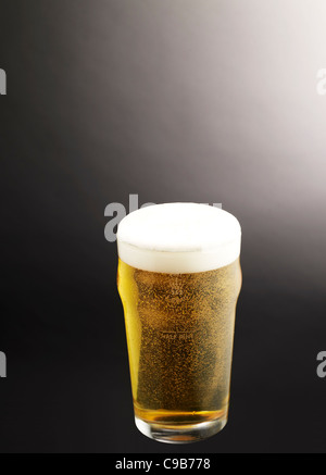 a pint of lager beer - Stock Photo