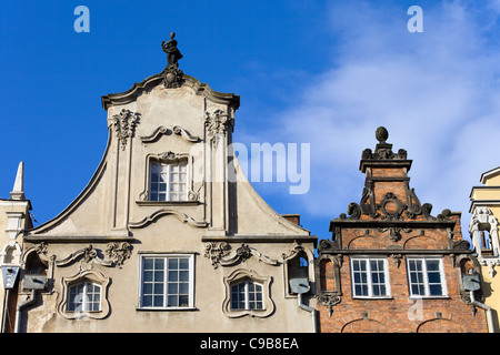 Ornate top of a tenement houses in the Old Town of Gdansk, Poland - Stock Photo