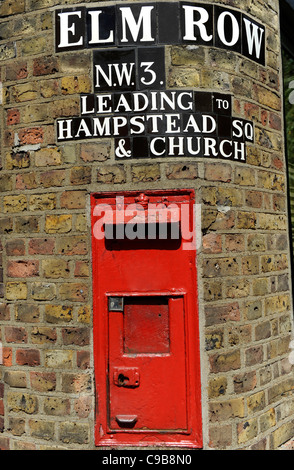 Old red letterbox set in wall, Hampstead, London - Stock Photo