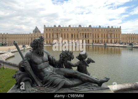 River allegory of Seine in front of Bassin du Midi and Corps de Logis of the castle Chateau de Versailles in Versailles, - Stock Photo