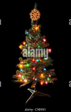 Decorated Christmas tree isolated on black background. - Stock Photo