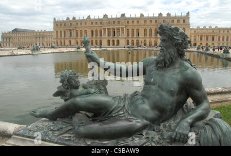 River allegory of Rhône in front of Bassin du Midi and Corps de Logis of the castle Chateau de Versailles in Versailles, - Stock Photo