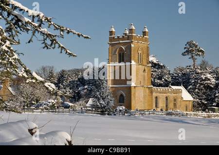 Cotswold village church in snow - Stock Photo