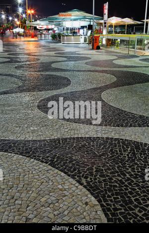 Wave Patterned Walkway with Kiosks at Night, Copacabana, Rio de Janeiro, Brazil - Stock Photo
