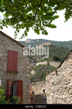 Fortified village of Villefranche-de-Conflent with Vauban's Fort Libéria on Mt. Belloc in Pyrénées-Orientales, France - Stock Photo