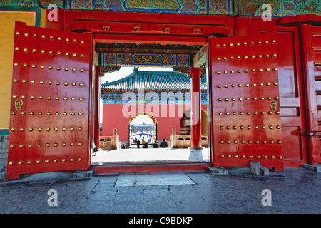 Red Gates with Lucky Number of Studs, Temple of Heaven, Beijing, China - Stock Photo