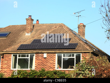 Solar Electricity Panels on a house roof. - Stock Photo