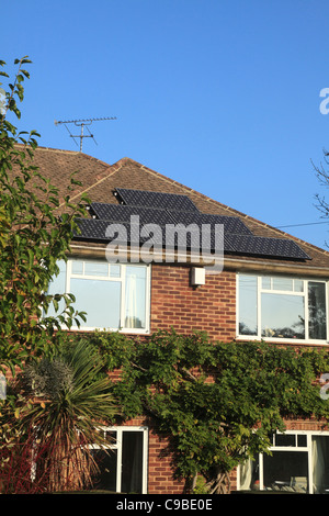 Solar Electricity Collector Panels on a House roof. - Stock Photo