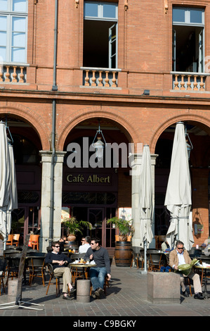 Outdoor terrace with guests at Cafe Albert on the Place de la Capitole in Toulouse, Midi-Pyrenees, France - Stock Photo