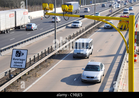 Average speed cameras & sign on the M25 motorway during contra flow operation & because of road works widening construction - Stock Photo