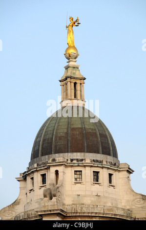 Bronze statue sculpture Lady Justice or Scales of Justice above new copper roof dome Old Bailey courthouse Central - Stock Photo