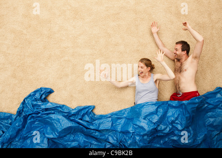 Germany, Young couple enjoying in water at beach - Stock Photo