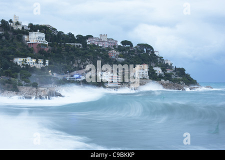 ROUGH SEA daylight time exposure of a rough sea striking the rocky promontory in the city of Nice, French Riviera, - Stock Photo