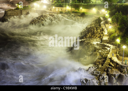ROUGH SEA 1.3-seconde night time exposure of a rough sea on the rocky shoreline in the city of Nice, French Riviera, - Stock Photo