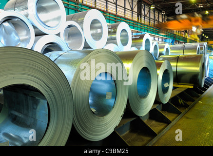 packed rolls of steel sheet - Stock Photo