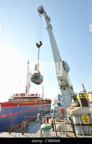 Rolls of steel sheet in the harbor - Stock Photo