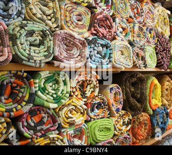 Colourful rugs on display - Stock Photo