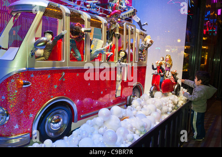 Paris, France, Child Enjoying, Looking in Galeries Lafayette Department Store Shop Front WIndow, Christmas Displays - Stock Photo