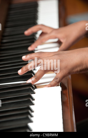 Childs hands playing piano, Johannesburg, Gauteng Province, South Africa - Stock Photo