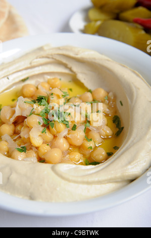 Hummus. A Levantine Arab dip or spread made from cooked, mashed chickpeas, blended with tahini - Stock Photo