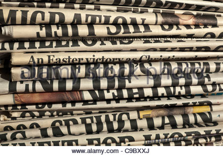 Stack of daily newspapers - Stock Photo
