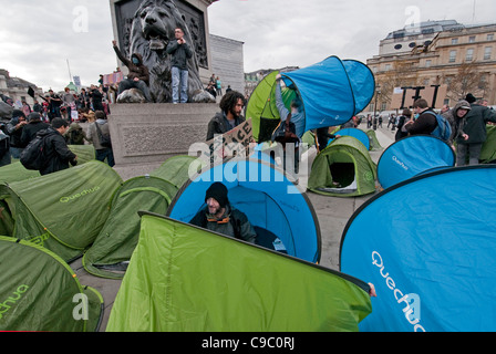 Occupying Trafalgar Square at Student protest through central London 9th November 2011 - Stock Photo